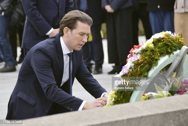 Sebastian Kurz chancellor of Austria lay a wreath at the cenotaph for the atomic bombing victims at Peace Memorial Park in Hiroshima western Japan on...