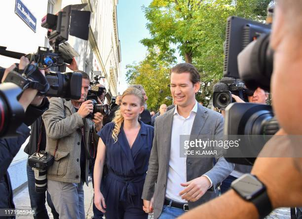 Sebastian Kurz leader of Austria's People's party and his girlfriend Susanne Thier arrive at a polling station during snap elections in Vienna...