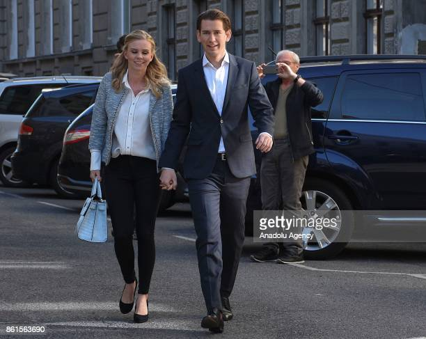 Sebastian Kurz leader of conservative OVP party and his girlfriend Susanne Thier arrive at a polling station to cast their votes in parliamentary...