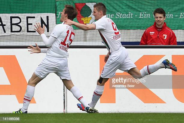 Sebastian Langkamp of Augsburg celebrates his first goal together with his teammate Torsten Oehrl during the German Bundesliga match between FC...