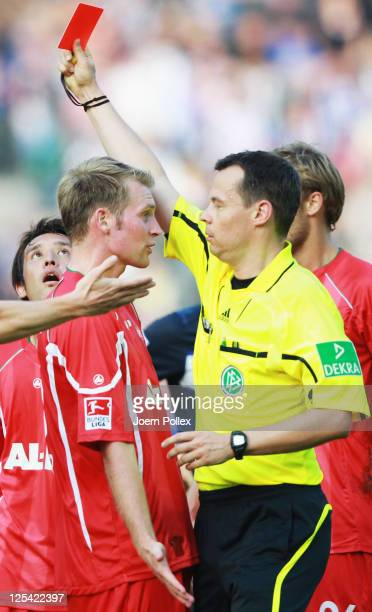 Sebastian Langkamp of Augsburg gets the red card from refereeMarkus Schmidt during the Bundesliga match between Hertha BSC Berlin and FC Augsburg at...