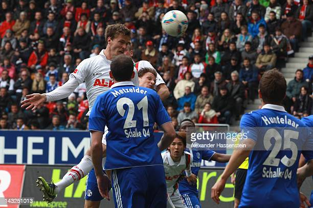 Sebastian Langkamp of Augsburg scores the opening goal during the Bundesliga match between FC Augsburg and FC Schalke 04 at SGL Arena on April 22...