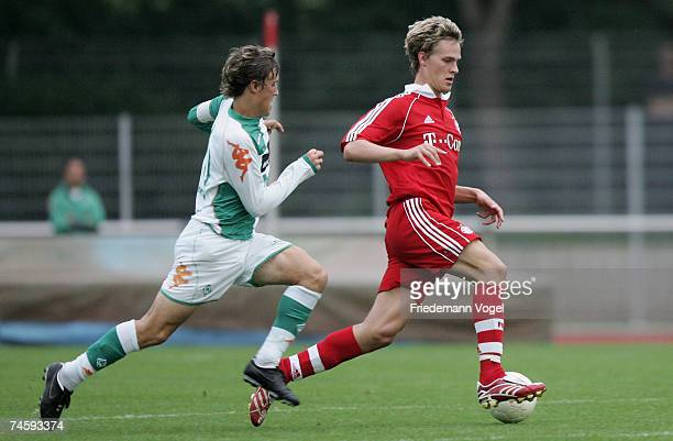 Sebastian Langkamp of Bayern tussles for the ball with Max Kruse of Werder during the A Juniors semi final match between Werder Bremen and Bayern...