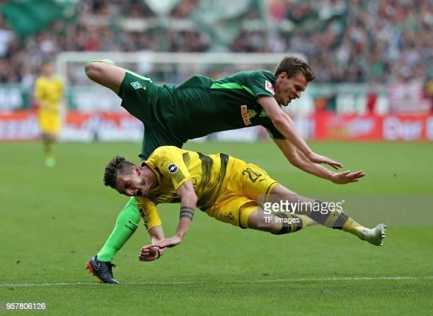 Sebastian Langkamp of Bremen and Maximilian Philipp of Dortmund battle for the ball during the Bundesliga match between SV Werder Bremen and Borussia...