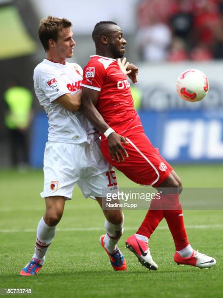 Sebastian Langkamp of FCA and Nando Rafael of Fortuna compete for the ball during the Bundesliga match between FC Augsburg v Fortuna Duesseldorf 1895...