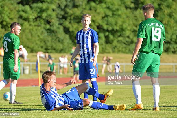 Sebastian Langkamp of Hertha BSC lays on the floor during the game between dem 1 FC Luebars and Hertha BSC on July 1 2015 in Berlin Germany