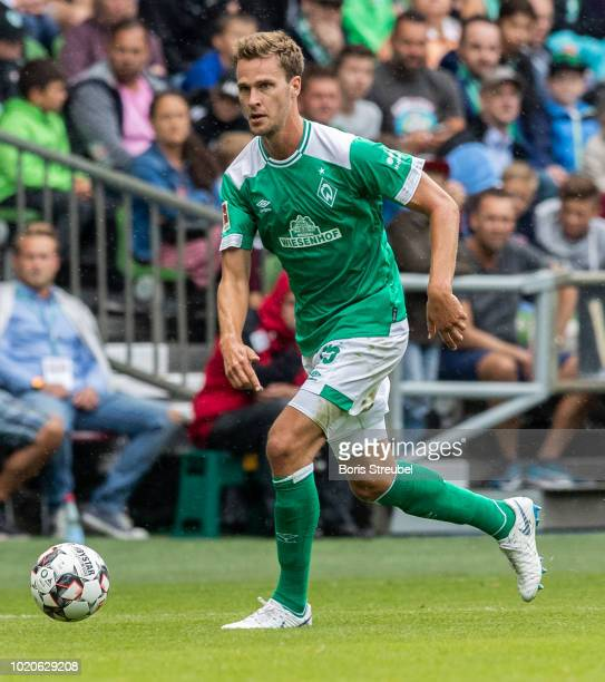Sebastian Langkamp of Werder Bremen runs with the ball during the Pre Season Friendly Match between Werder Bremen and FC Villareal at Weserstadion on...