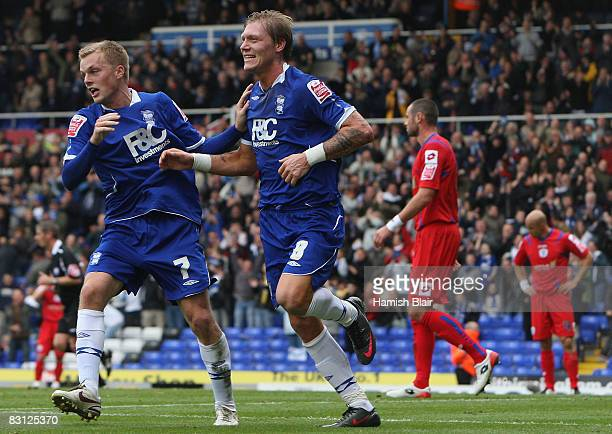 Sebastian Larsson and Garry O'Connor of Birmingham City celebrate the goal of team mate Kevin Phillips during the Coca Cola Championship match...