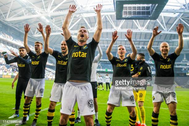 Sebastian Larsson and players from AIK celebrate their 2-0 victory in front of their supporters during an Allsvenskan match between AIK and Hammarby...