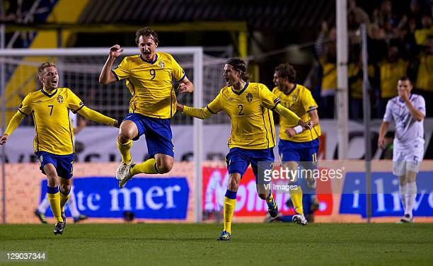 Sebastian Larsson, Kim Kallstrom and Mikael Lustig of Sweden during the EURO 2012 Qualifying match between Sweden and Netherlands at the Rasunda...