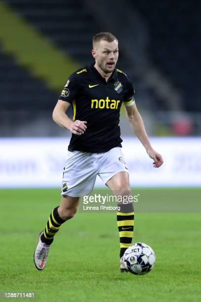 Sebastian Larsson of AIK runs with the ball during the Allsvenskan match between AIK and Kalmar FF at Friends arena on November 30, 2020 in Solna,...