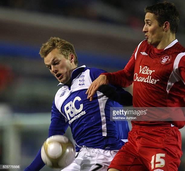 Sebastian Larsson of Birmingham City and Chris Cohen of Nottingham Forest
