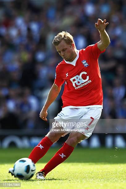 Sebastian Larsson of Birmingham City takes a free kick during the Barclays Premier League match between Blackburn Rovers and Birmingham City at Ewood...