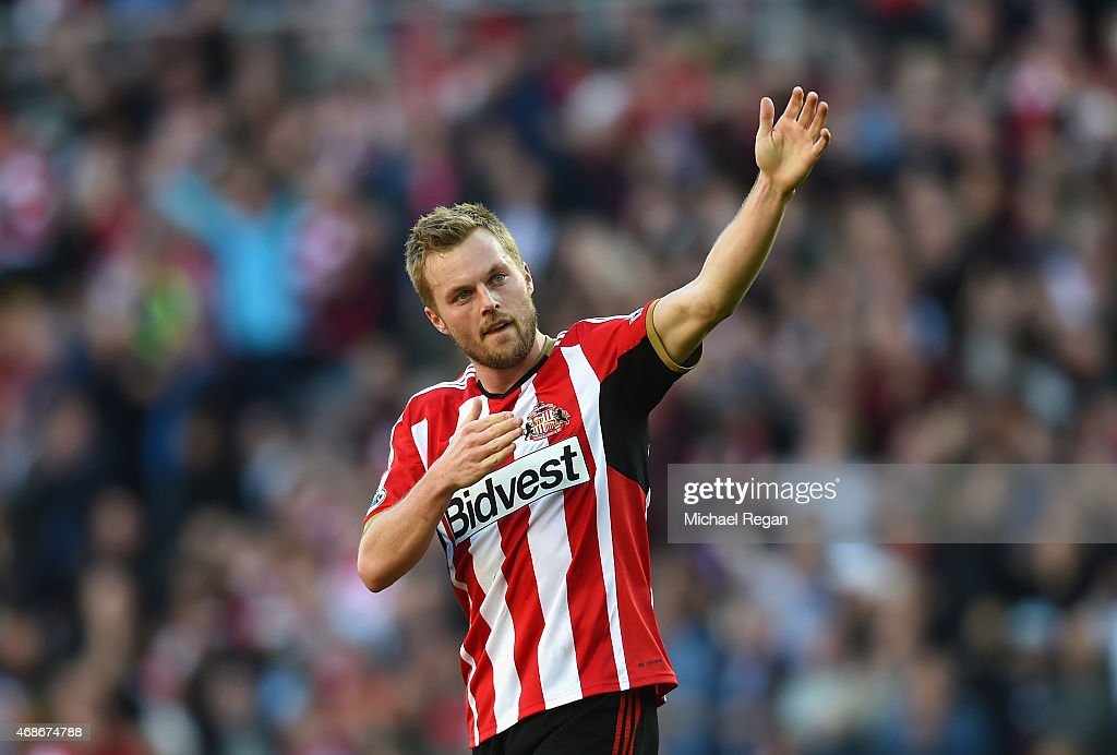 Sebastian Larsson of Sunderland acknowledges the fans during the Barclays Premier League match between Sunderland and Newcastle United at Stadium of Light on April 5, 2015 in Sunderland, England.