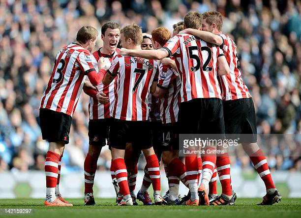 Sebastian Larsson of Sunderland is mobbed by his team mates after scoring the opening goal during the Barclays Premier League match between...