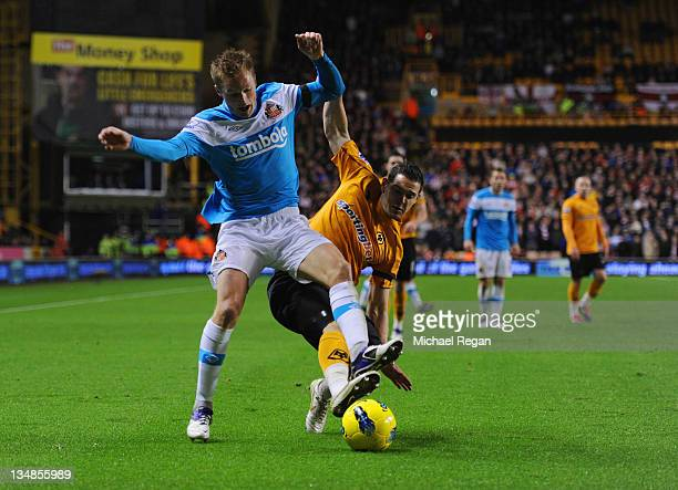 Sebastian Larsson of Sunderland is tackled by Matt Jarvis of Wolves during the Barclays Premier League match between Wolverhampton Wanderers and...
