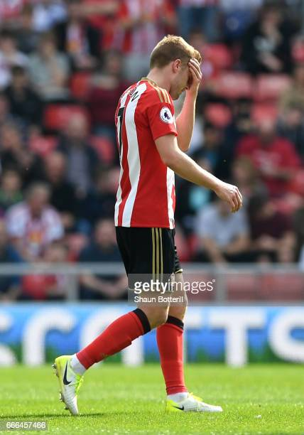 Sebastian Larsson of Sunderland leaves the field after being sent off for a foul on Ander Herrera of Manchester United during the Premier League...