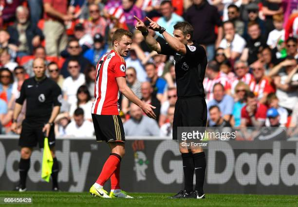 Sebastian Larsson of Sunderland reacts after being sent off by referee Craig Pawson for a challenge on Ander Herrera of Manchester United during the...