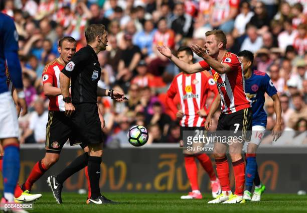 Sebastian Larsson of Sunderland reacts before being sent off by referee Craig Pawson for a challenge on Ander Herrera of Manchester United during the...