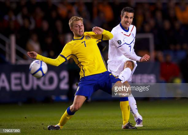 Sebastian Larsson of Sweden and Robin van Persie of Holland during the EURO 2012 Qualifying match between Sweden and Netherlands at the Rasunda...