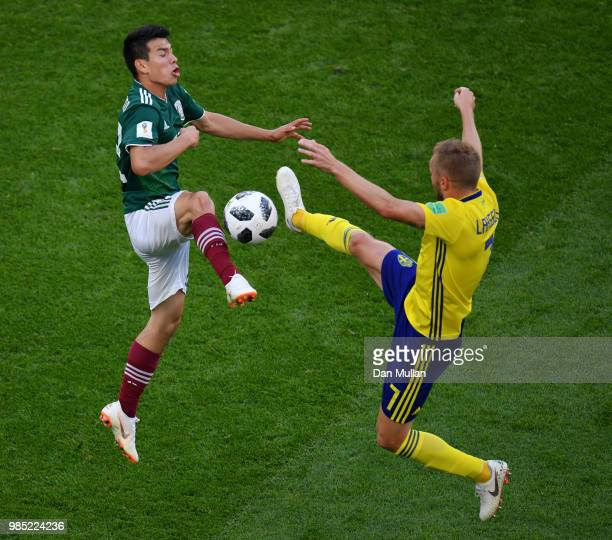 Sebastian Larsson of Sweden clashes with Hirving Lozano of Mexico during the 2018 FIFA World Cup Russia group F match between Mexico and Sweden at...