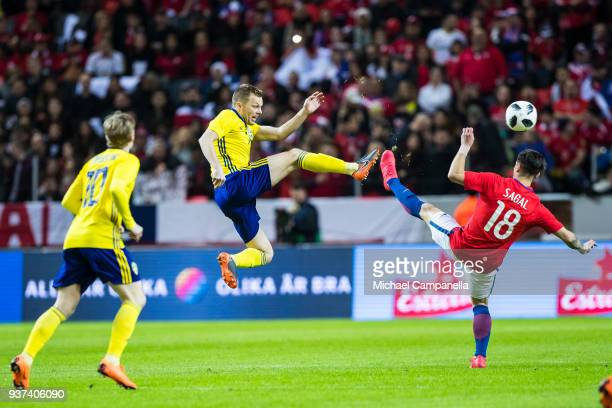 Sebastian Larsson of Sweden clears the ball away in mid air from Angelo Sagal of Chile during an international friendly between Sweden and Chile at...