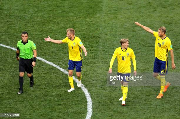 Sebastian Larsson of Sweden confronts referee Joel Aguilar before he consults VAR to make a penalty decision which Joel Aguilar then awards Sweden...