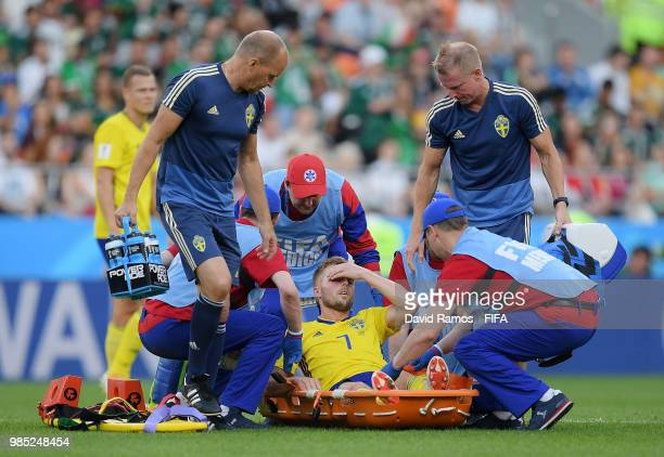 Sebastian Larsson of Sweden is carried out of the pitch during the 2018 FIFA World Cup Russia group F match between Mexico and Sweden at Ekaterinburg...