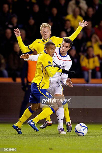 Sebastian Larsson of Sweden, Robin van Persie of Holland and Martin Olsson of Sweden in action during the EURO 2012 Qualifying match between Sweden...
