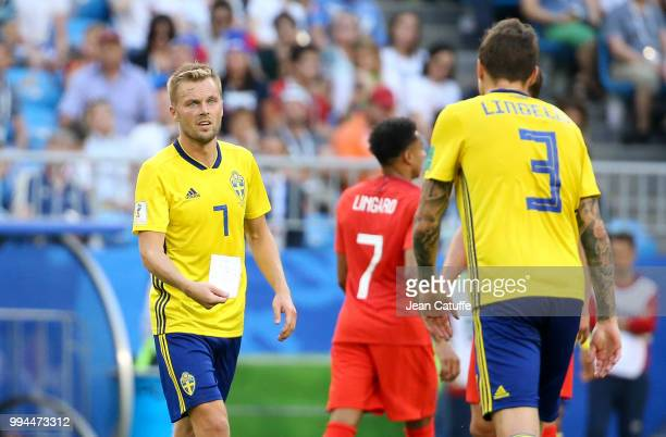 Sebastian Larsson Victor Lindelof of Sweden read a note given by their coach in the middle of the 2018 FIFA World Cup Russia Quarter Final match...