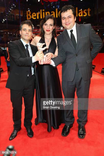 Sebastian LelioDaniela Vega and Gonzalo Maza pose with silver Bear for Best Screenplay award for 'Una Mujer Fantastica' after the closing ceremony of...