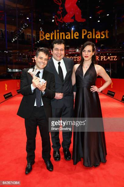 Sebastian LelioGonzalo Maza and Daniela Vega pose with silver Bear for Best Screenplay award for 'Una Mujer Fantastica' after the closing ceremony of...
