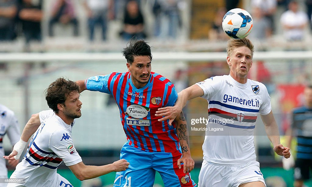 Sebastian Leto (C) of Catania competes for the ball with Andrea Costa (L) and Bartosz Salamon of Sampdoria during the Serie A match between Calcio Catania and UC Sampdoria at Stadio Angelo Massimino on April 19, 2014 in Catania, Italy.