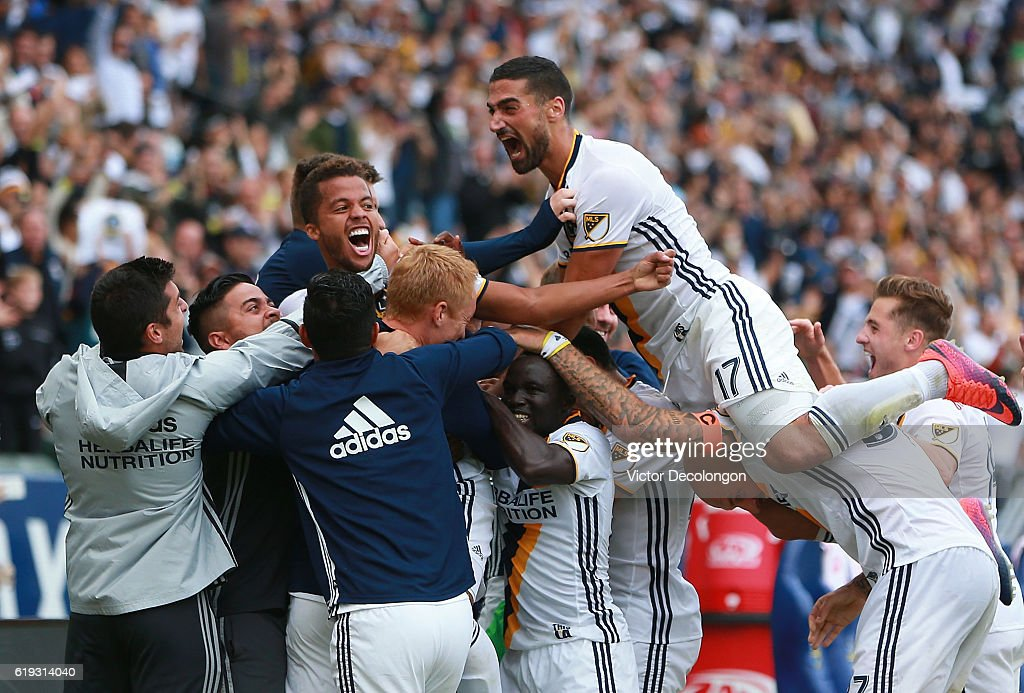 Sebastian Lletget #17 Los Angeles Galaxy teammates mob teammate Giovani dos Santos #10 after dos Santos, third from left, scored a goal during the second half of leg one of the Audi 2016 MLS Cup Playoff Western Conference Semfinal between the Colorado Rapids and the Los Angeles Galaxy at StubHub Center on October 30, 2016 in Carson, California.