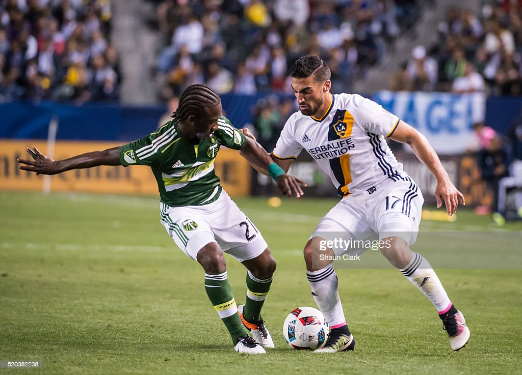 Sebastian Lletget #17 of Los Angeles Galaxy battles Diego Chara #21 of Portland Timbers during Los Angeles Galaxy's MLS match against Portland Timbers at the StubHub Center on April 10, 2016 in Carson, California. The match ended in a 1-1 tie
