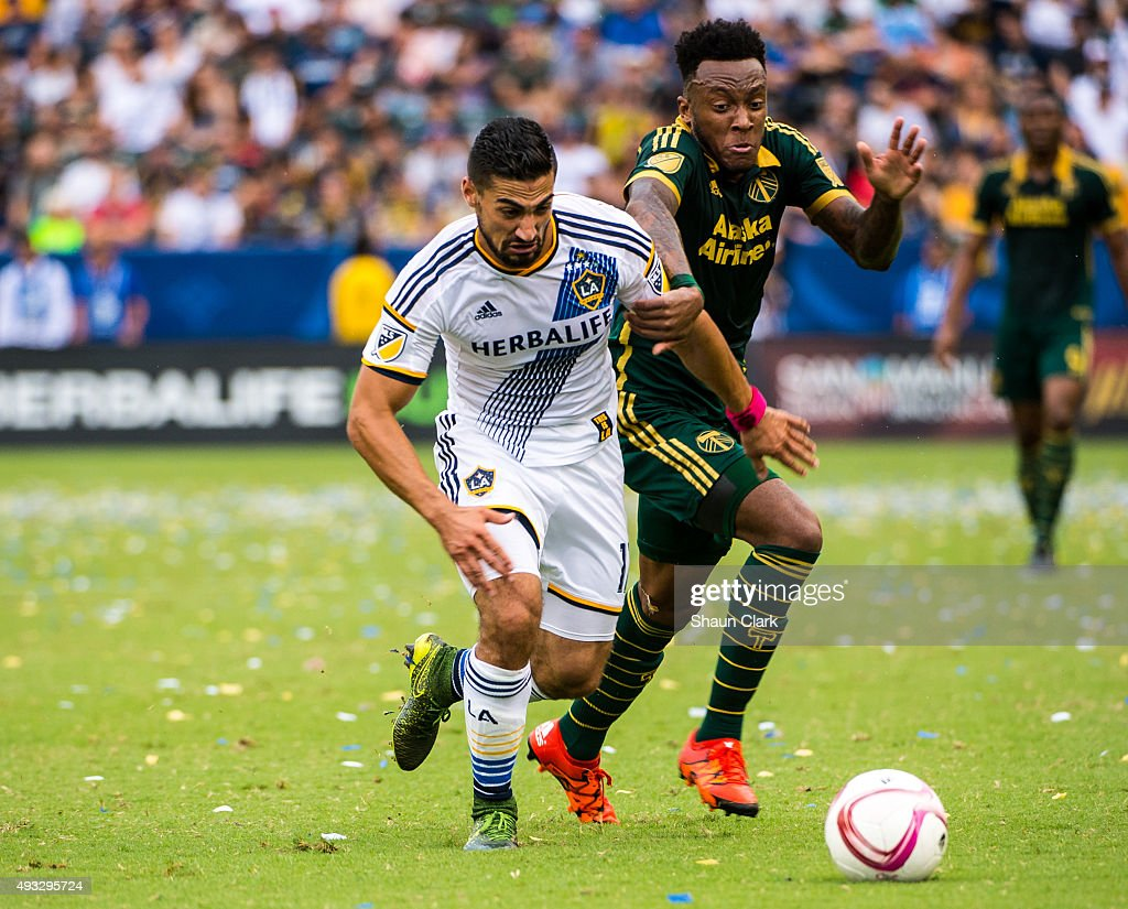 Sebastian Lletget #17 of Los Angeles Galaxy battles Rodney Wallace #22 of Portland Timbers during Los Angeles Galaxy's MLS match against Portland Timbers at the StubHub Center on October 18, 2015 in Carson, California. The Portland Timbers won the match 5-2
