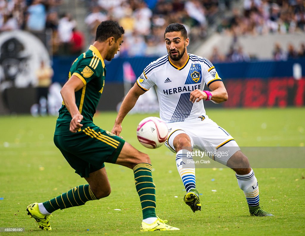 Sebastian Lletget #17 of Los Angeles Galaxy dribbles the ball during Los Angeles Galaxy's MLS match against Portland Timbers at the StubHub Center on October 18, 2015 in Carson, California. The Portland Timbers won the match 5-2