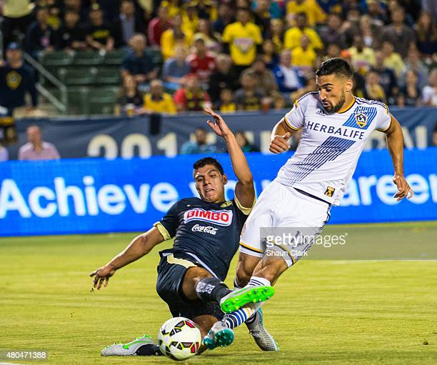 Sebastian Lletget of Los Angeles Galaxy takes a shot on goal as Erik Pimentel of Club America defends during the International Champions Cup 2015...