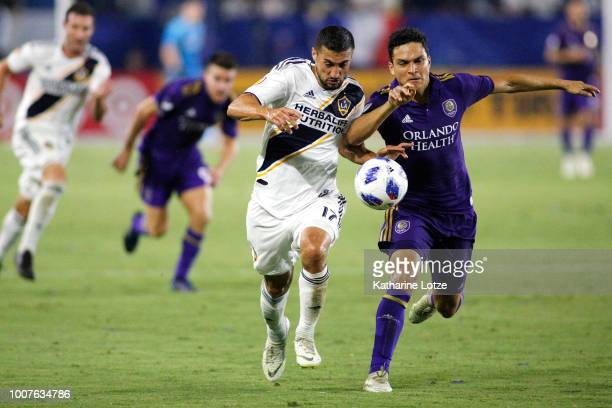 Sebastian Lletget of the Los Angeles Galaxy and Tony Rocha of Orlando City SC fight for control of the ball at StubHub Center on July 29 2018 in...