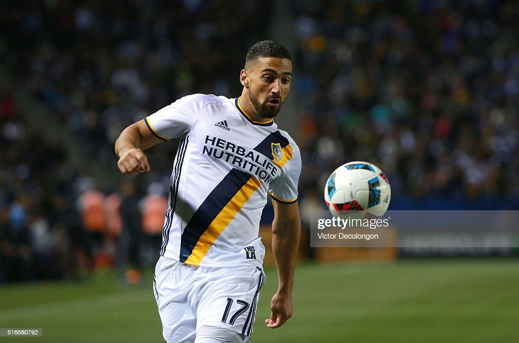 Sebastian Lletget #17 of the Los Angeles Galaxy paces the ball on attack against D.C. United during the MLS match at StubHub Center on March 6, 2016 in Carson, California. The Galaxy defeated United 4-1.