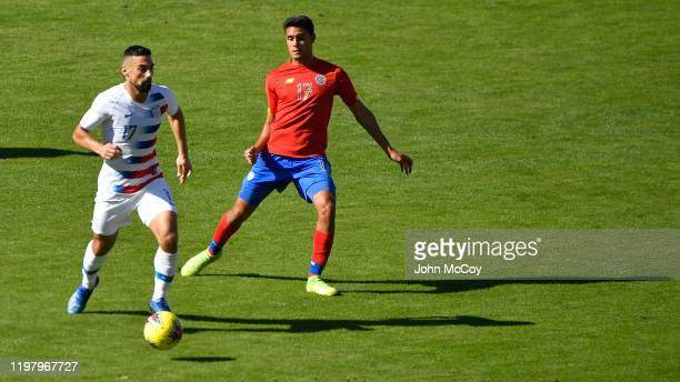 Sebastian Lletget of the United States and Yeltsin Tejeda Costa Rica fight for the ball during a game at Dignity Health Sports Park on February 1...