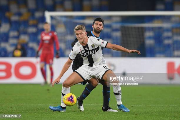 Sebastian Luperto of SSC Napoli vies with Cornelius Andreas of Parma Calcio during the Serie A match between SSC Napoli and Parma Calcio at Stadio...