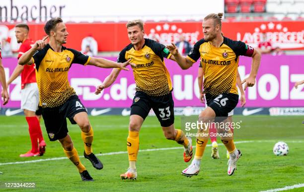 Sebastian Mai of Dynamo Dresden celebrates the first goal for his team with his teammates during the 3. Liga match between 1. FC Kaiserslautern and...