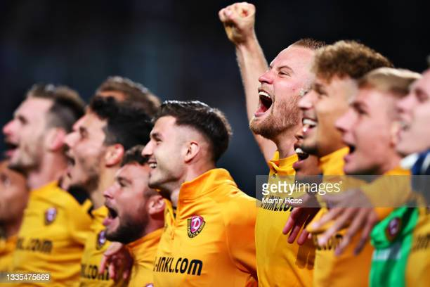Sebastian Mai of Dynamo Dresden celebrates with his team and the fans following victory during the Second Bundesliga match between FC Hansa Rostock...