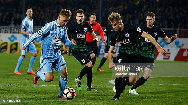 Sebastian Mai of Muenster challenges Bjoern Jopek of Chemnitz during the Third League match between Preussen Muenster and Chemnitzer FC at...