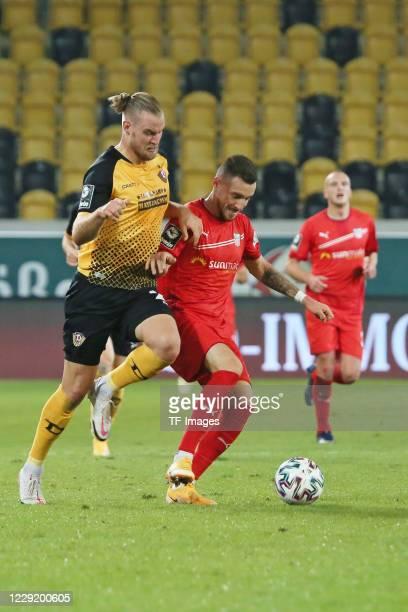Sebastian Mai of SG Dynamo Dresden and Morris Schroeter of FSV Zwickau battle for the ball during the 3 Liga match between Dynamo Dresden and FSV...