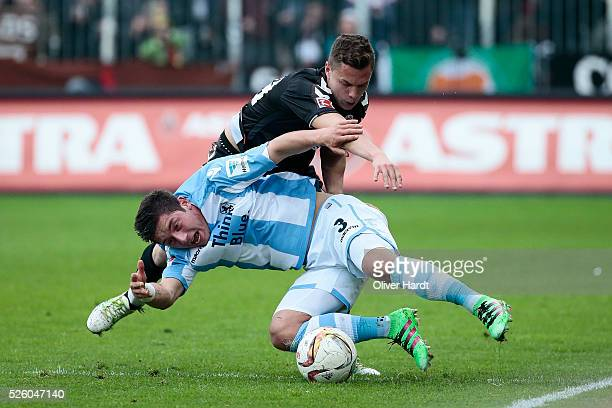 Sebastian Maier of Hamburg and Maximilan Wittek of Muenchen compete for the ball during the Second Bundesliga match between FC St Pauli and 1860...