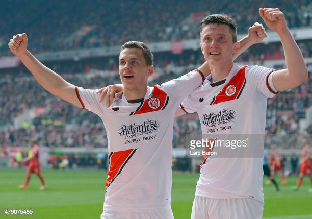 Sebastian Maier of Pauli celebrates with team mate Michael Gregoritsch after scoring his teams first goal during the Second Bundesliga match between...
