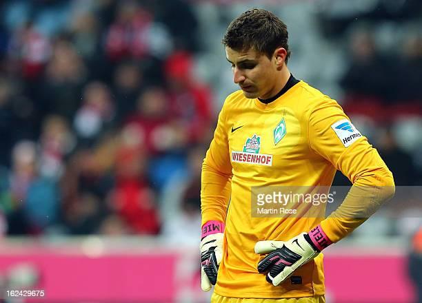 Sebastian Mielitz goalkeeper of Bremen walks off dejected after the Bundesliga match between Bayern Muenchen and Werder Bremen at Allianz Arena on...