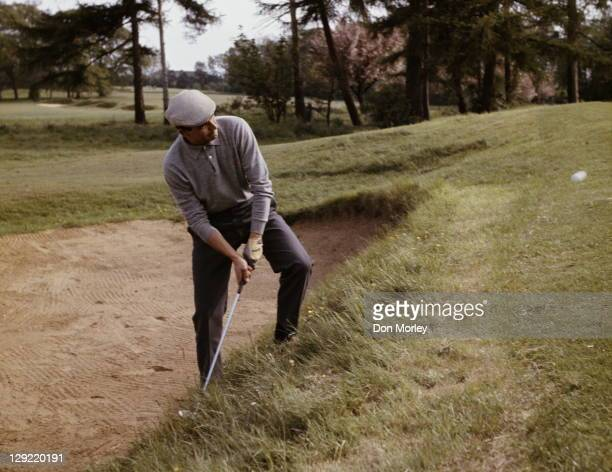 Sebastian Miguel of Spain chips out of a bunker during the Piccadilly World Match Play Championship held on 9th October 1964 at The Wentworth Golf...